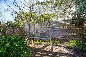 Timber slatted wall courtyard