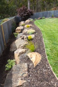 Lawn edging with boulders