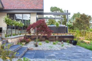 Paving with landing and timber retaining wall