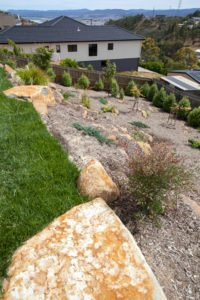 Rock garden and green grass