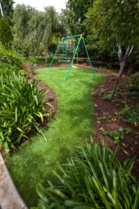Swingset on green lawn