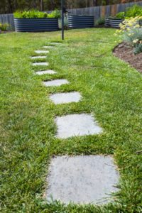 stepping stones through artificial turf