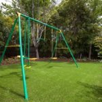 swing set, lawn, grass, turf, artificial turf, irrigation, sprinkler, pop-up sprinklers